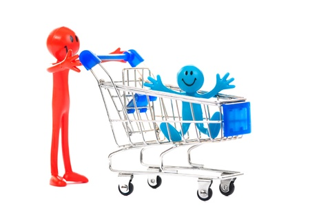 Red smiling man and his son in the cart  Isolated on white Stock Photo - 19604509