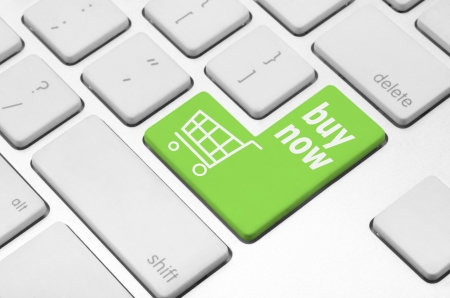 Business finance concept  Shopping cart key on the computer keyboard Stock Photo - 20341416