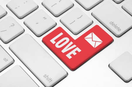Love concept  Love key on the computer keyboard Stock Photo - 20341391