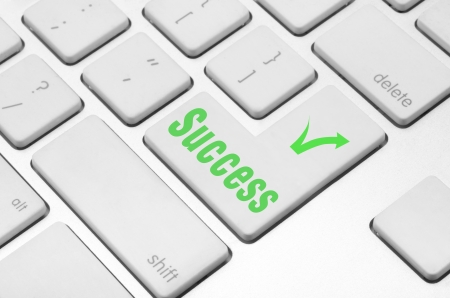 Business finance concept  Success key on the computer keyboard Stock Photo - 20341407