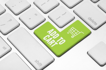 Business finance concept  Shopping cart key on the computer keyboard Stock Photo - 20341435