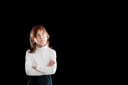 exact science: girl wondering and looking up  isolated on black Stock Photo