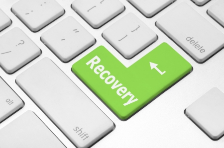 Business concept  Recovery key on the computer keyboard Фото со стока
