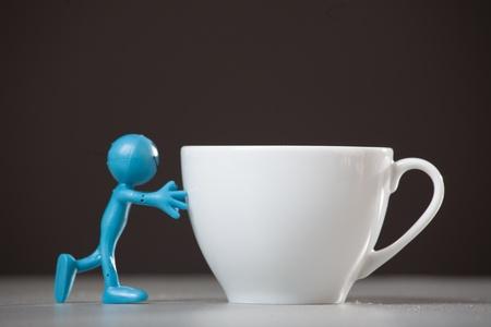 big break: Blue man pushing a coffee cup  Concept  Stock Photo