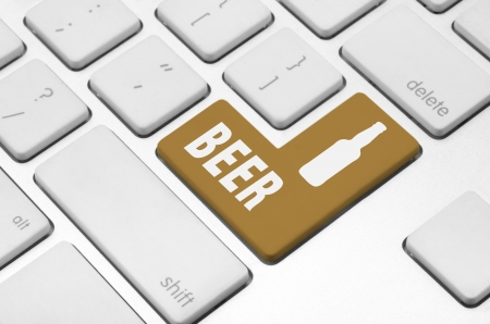 concept  Beer time key on the computer keyboard photo