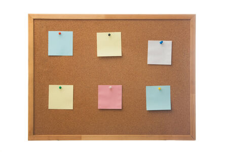Corkboard and blank paper notes  Isolated on white