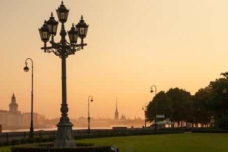 Sunrise in St  Petersburg, Russia  street lamp - symbol of the city  photo