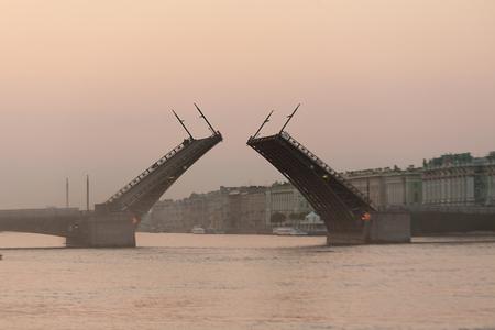 drawbridge: White nights of St Petersburg, Russia  View of the Hermitage Museum and raised Palace Bridge  Stock Photo