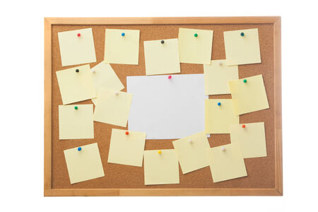 Corkboard and blank paper notes  Isolated on white  photo