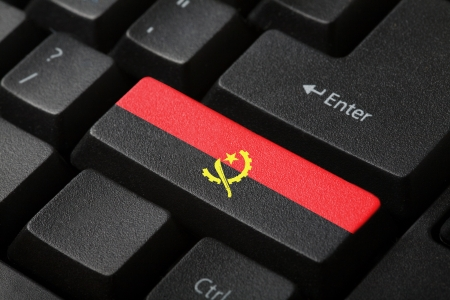 The Angolan flag button on the keyboard  close-up photo