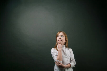 primus: girl wondering and looking up  isolated on black Stock Photo