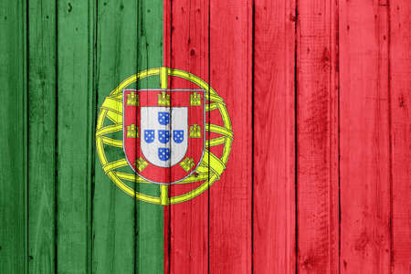 The Portuguese flag painted on a wooden fence photo