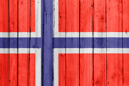 The Norwegian flag painted on a wooden fence photo