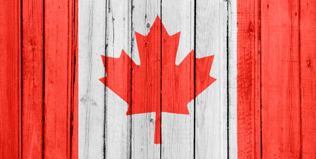 The Canadian flag painted on a wooden fence photo