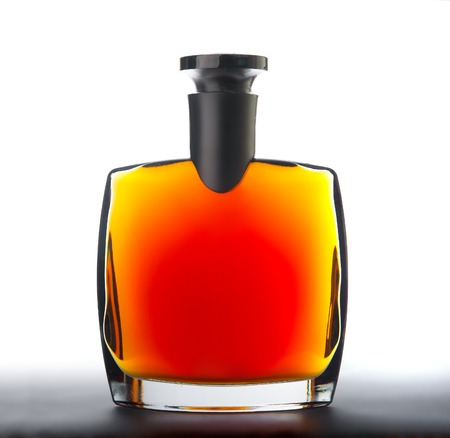 liqueur labels: The bottle of brandy  cognac   Isolated on white