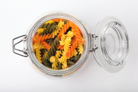 Pasta in a jar on white background. Top view photo