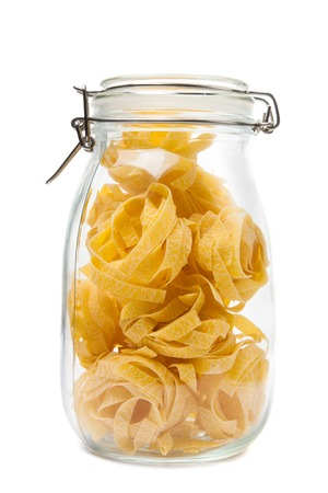 Pasta in a jar  Isolated on white background  photo