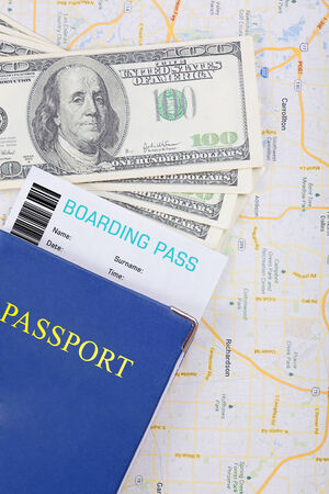 The travel concept  Passport, dollars, tickets on map  Closeup  photo