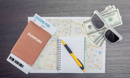 customs official: The travel concept  Passport, dollars, tickets, map and note - on wooden surface  Closeup  Stock Photo
