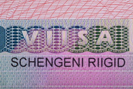 schengen: Fragment of the Schengen visa of Estonia in the passport Stock Photo