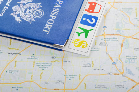 The travel concept  Passport, guide, tickets on map  Closeup  photo