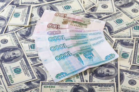 roubles: Russian roubles bills laying over dollars background