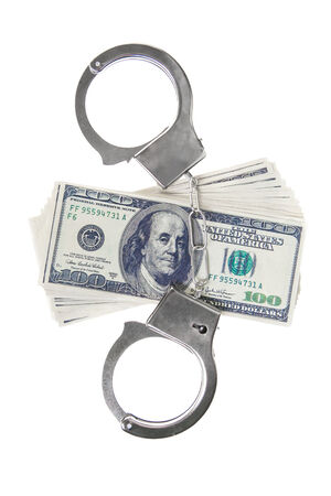 handcuffs and dollars isolated in white background photo
