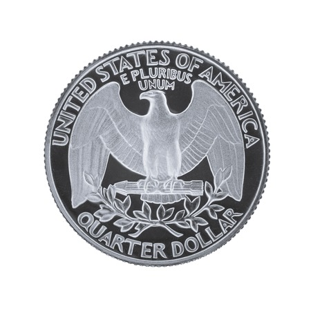 25 cents: The reverse side of a USA 25 cent - quarter coin, depicting USAs coat of arms - the bald eagle. Isolated on white background. Stock Photo