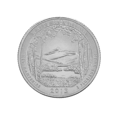 25 cents: US quarter coin, 25 cents. White Mountain New Hampshire commemorative quarter coin - isolated on white Stock Photo