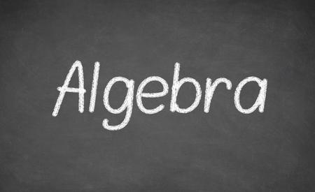 Algebra lesson on blackboard or chalkboard. written in white chalk