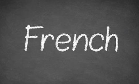 teaching crayons: French lesson on blackboard or chalkboard. written in white chalk