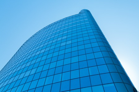 intresting: The top of modern high rise building. Blue sky. Toning Stock Photo