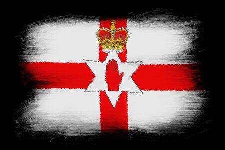 ulster: Flag of Northern Ireland - Painted grunge flag, brush strokes. Isolated on black background. Stock Photo