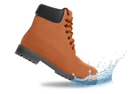 Brown boot and water splash. Side view Stock Photo