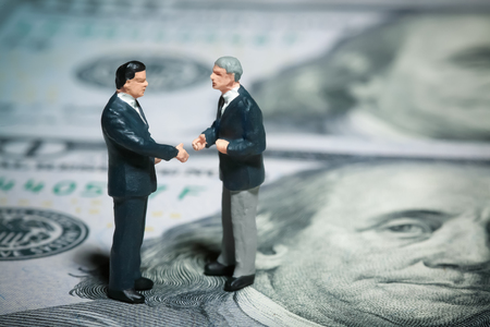 Miniature figurines of two discussing businessmen Stock Photo