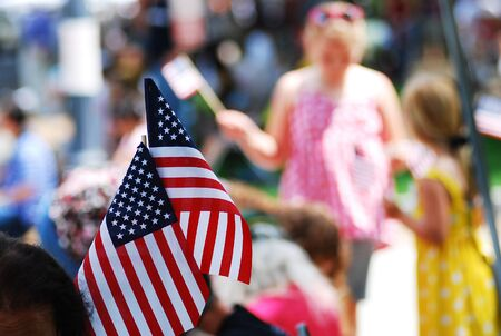 American flag show by people on 4th of july parade, god bless America Imagens