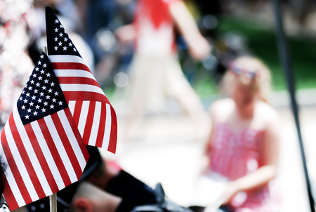 American flag show by people on 4th of july parade, god bless America 写真素材