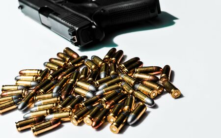 9 mm. bullets with hand gun on white background