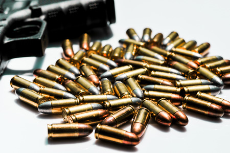 9mm ammo: 9 mm. bullets with hand gun on white background