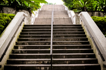 Stair Step In The Park With Stainless Steel Handrail, business concept Stockfoto