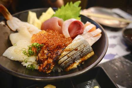 Japanese food. sushi and sashimi big set include salmon, tuna, otoro and lobster, Asian people eating sashimi set in Asian restaurant. Hirame sashimi,salmon sashimi and tuna sashimi dish. 写真素材