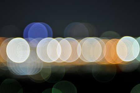 Colorful defocused bokeh lights in blur night background, abstract background of colorful Bokeh