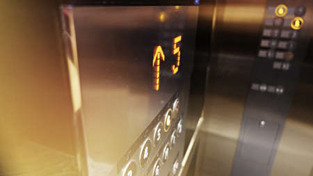 The fifth floor showing on led light and another buttons in the elevator 写真素材
