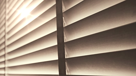 Evening sun light outside wooden window blinds, sunshine and shadow on window blind and, decorative interior home concept