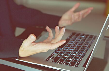 Man's hands on laptop keyboard. side view of human hands, laptop keyboard, notebook on table background. Education, business, emotional of people concept