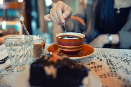 coffee cup and chocolate dessert on table vintage style