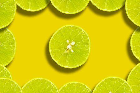 Half lemon pattern flat lay on a vivid yellow background