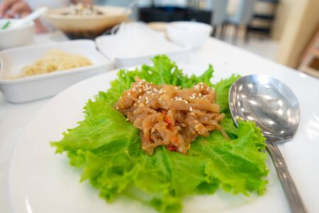 traditional Chinese food Jellyfish salad Served with green lettuce.