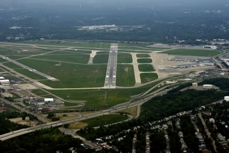 approaching: Ariel view of a runway of a medium sized US airport as viewed from the cockppit of an approaching airliner