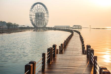 waterwheel: boardwalk and waterwheel at Lake Tai